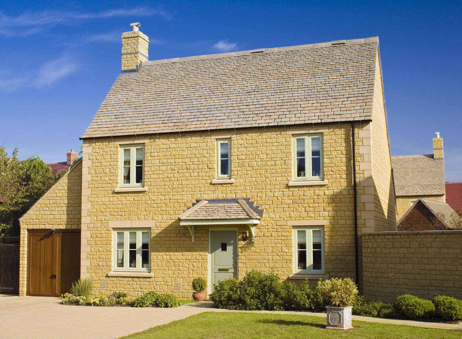large yellow brick house with slate roof